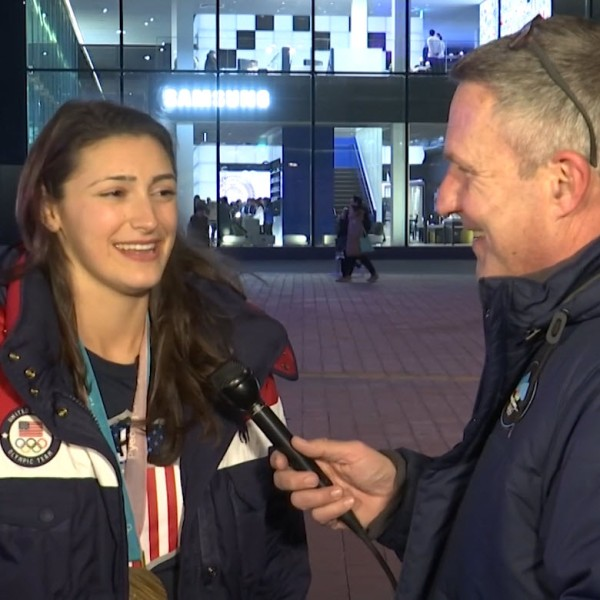 Jack talks with Olympic gold medalist Megan Heller of Team USA Hockey_396005