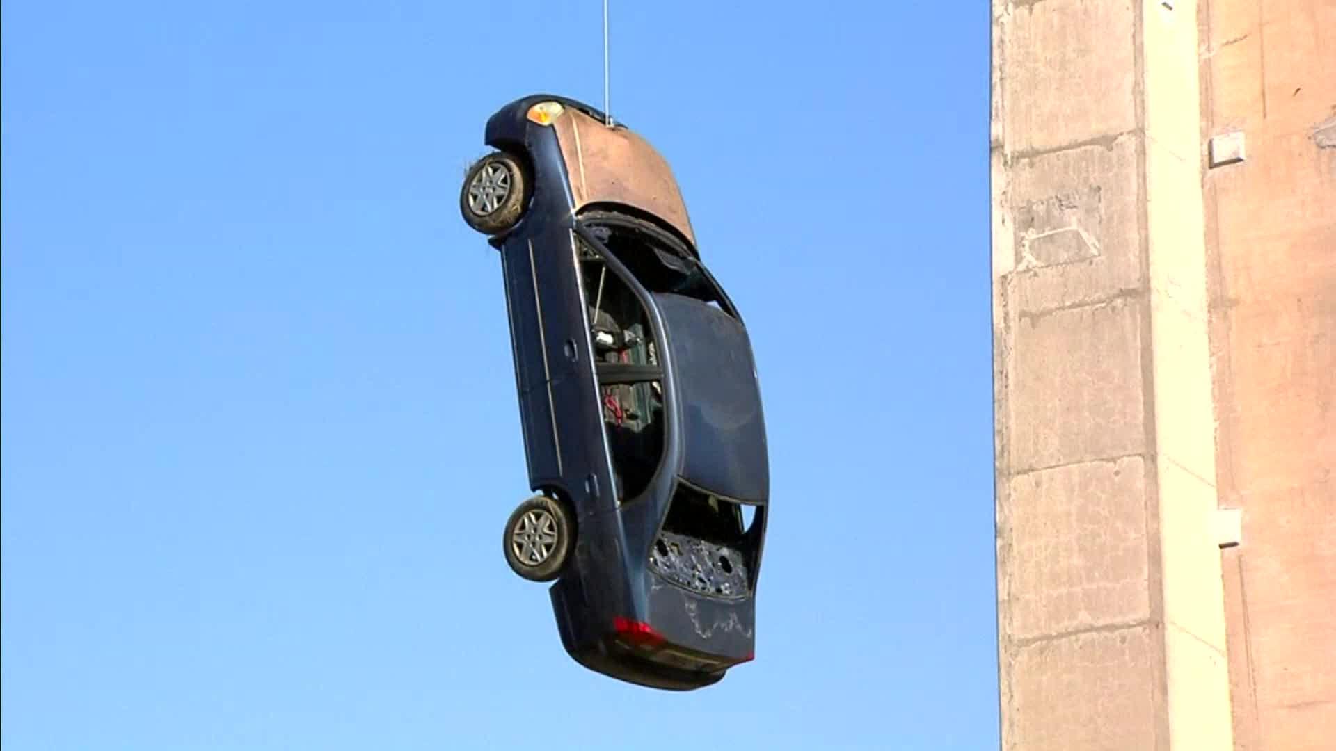 dangling car_1525291718904.jpg-846652698.jpg