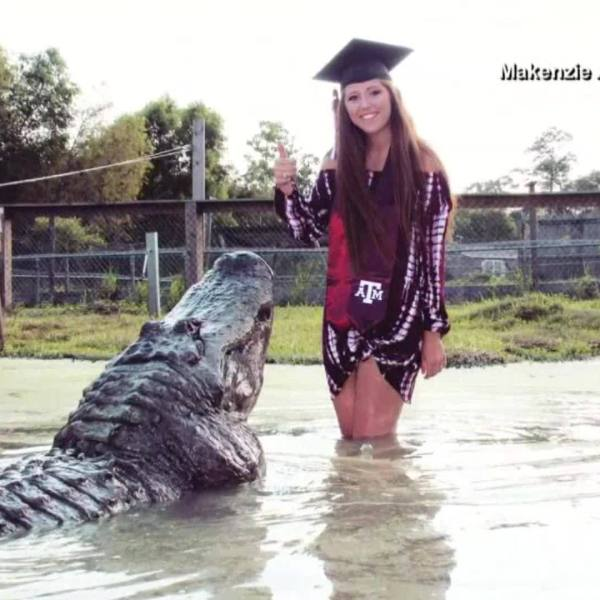 Graduate to-be takes photos with a gator