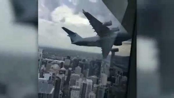 CNN VOD An Australian Air Force Globemaster cruises low through Brisbane, startling onlookers