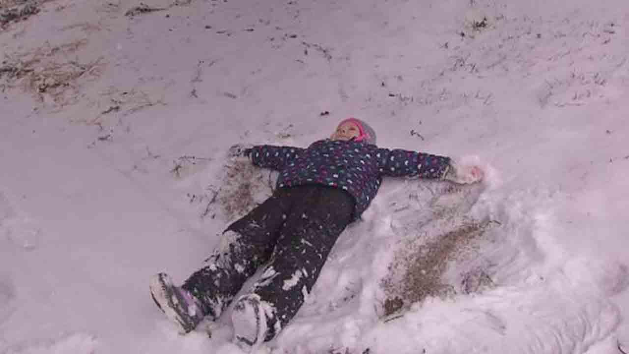 snow kid making snow angel_1547321740930.JPG.jpg