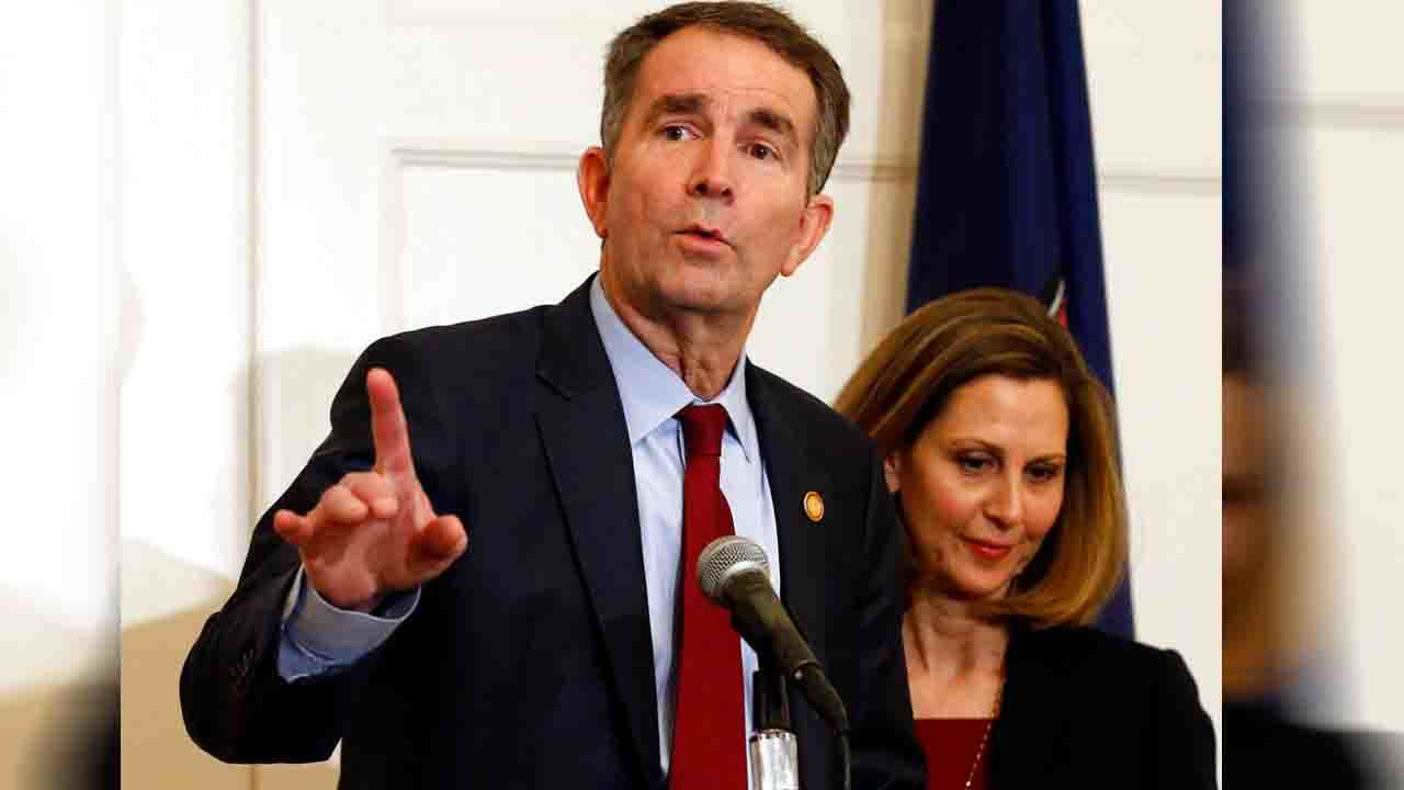 Gov. Northam says he wasn't in racist photo, won't resign