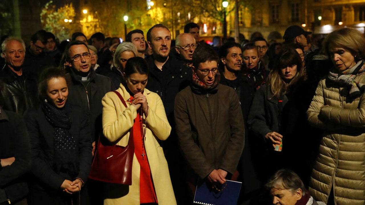 Prayers, hymns, community shared in firelight of Notre Dame