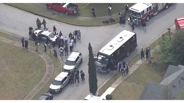 officers shot in Georgia neighborhood_1554396012619.JPG.jpg