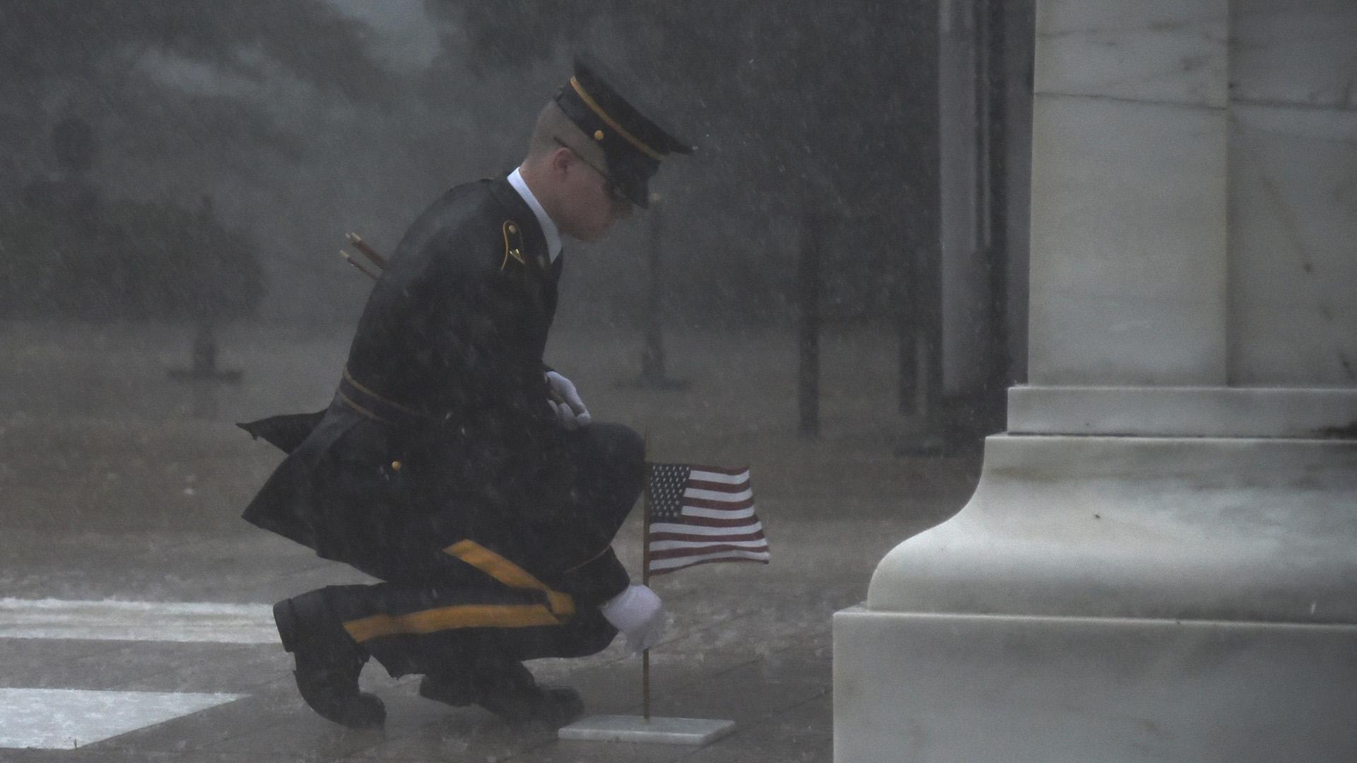 Soldier braves severe weather to honor fallen_1558867299452.jpg-846652698.jpg