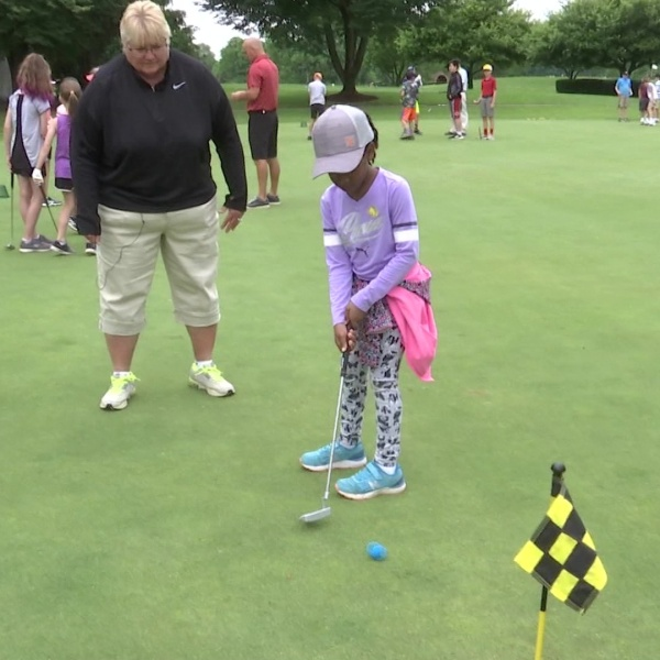 Girls take part in Women's Golf Day lessons