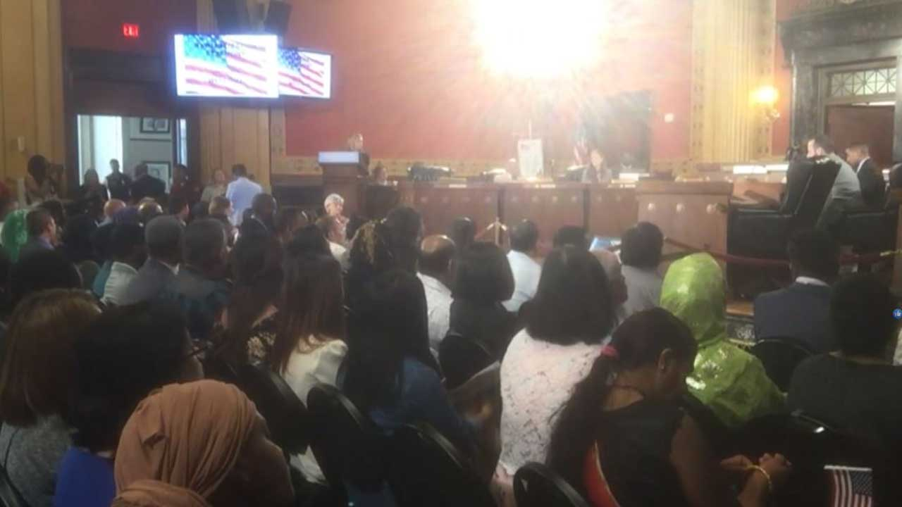 Over 100 become U S  citizens at first-ever naturalization ceremony