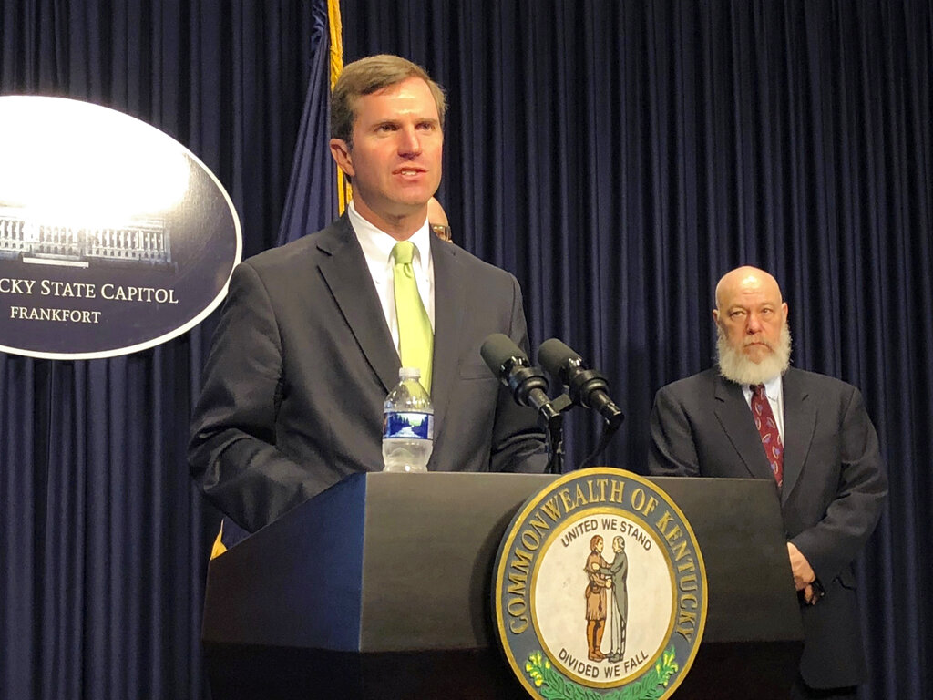 In this March 13, 2020 file photo, Kentucky Gov. Andy Beshear discusses developments in Kentucky regarding the new coronavirus in Frankfort, Ky. Beshear ordered bars and restaurant dine-in services to close in another aggressive step to contain the new coronavirus as the state reported its first death linked to the illness.(AP Photo/Bruce Schreiner)