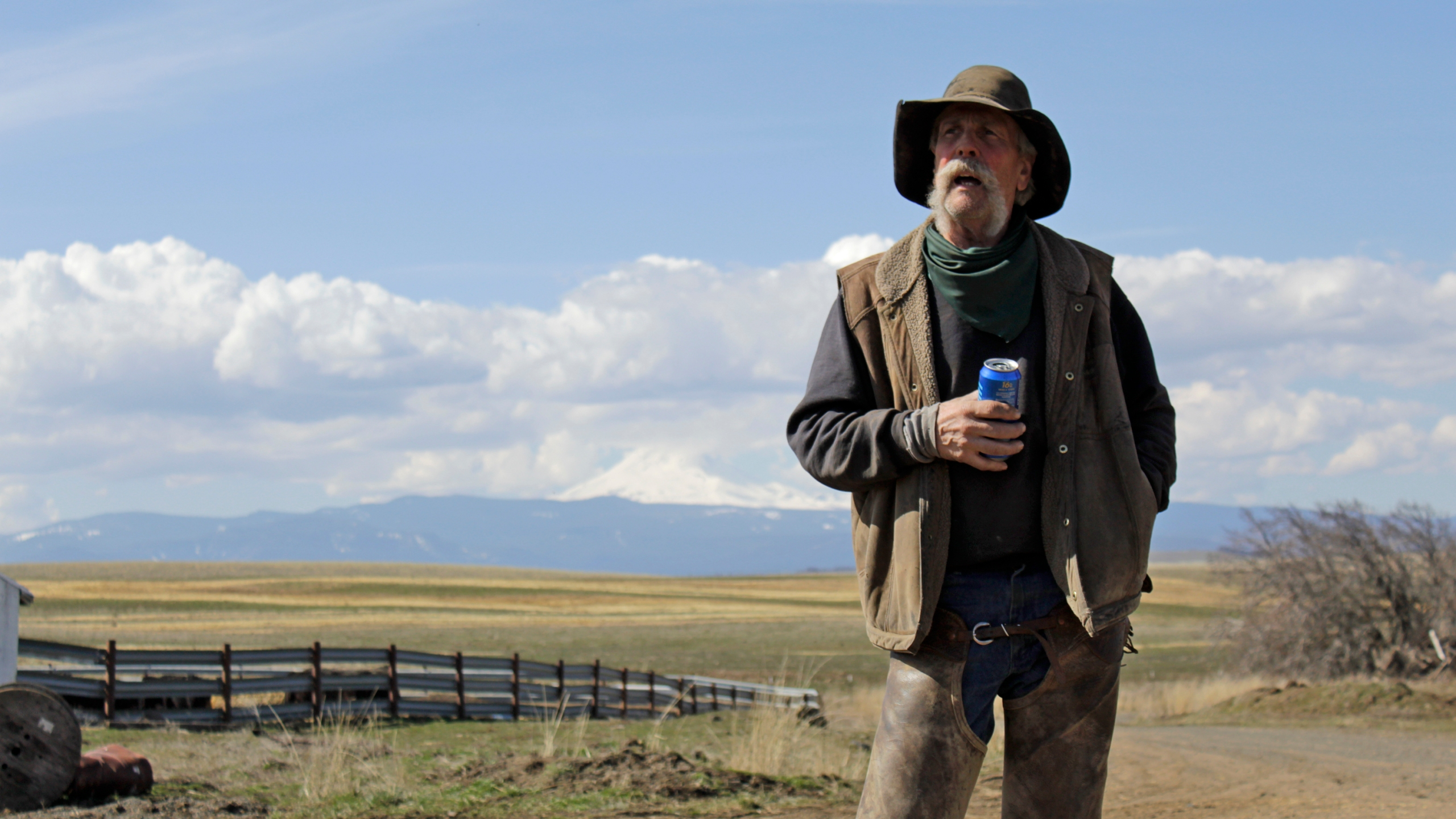 Cattle rancher Mike Filbin stands on his property in Dufur, Ore., after herding some cows and talks about the impact the new coronavirus is having on his rural community. Tiny towns tucked into Oregon's windswept plains and cattle ranches miles from anywhere in South Dakota might not have had a single case of the new coronavirus yet, but their residents fear the spread of the disease to areas with scarce medical resources, the social isolation that comes when the only diner in town closes its doors and the economic free fall that's already hitting them hard. (AP Photo/Gillian Flaccus)