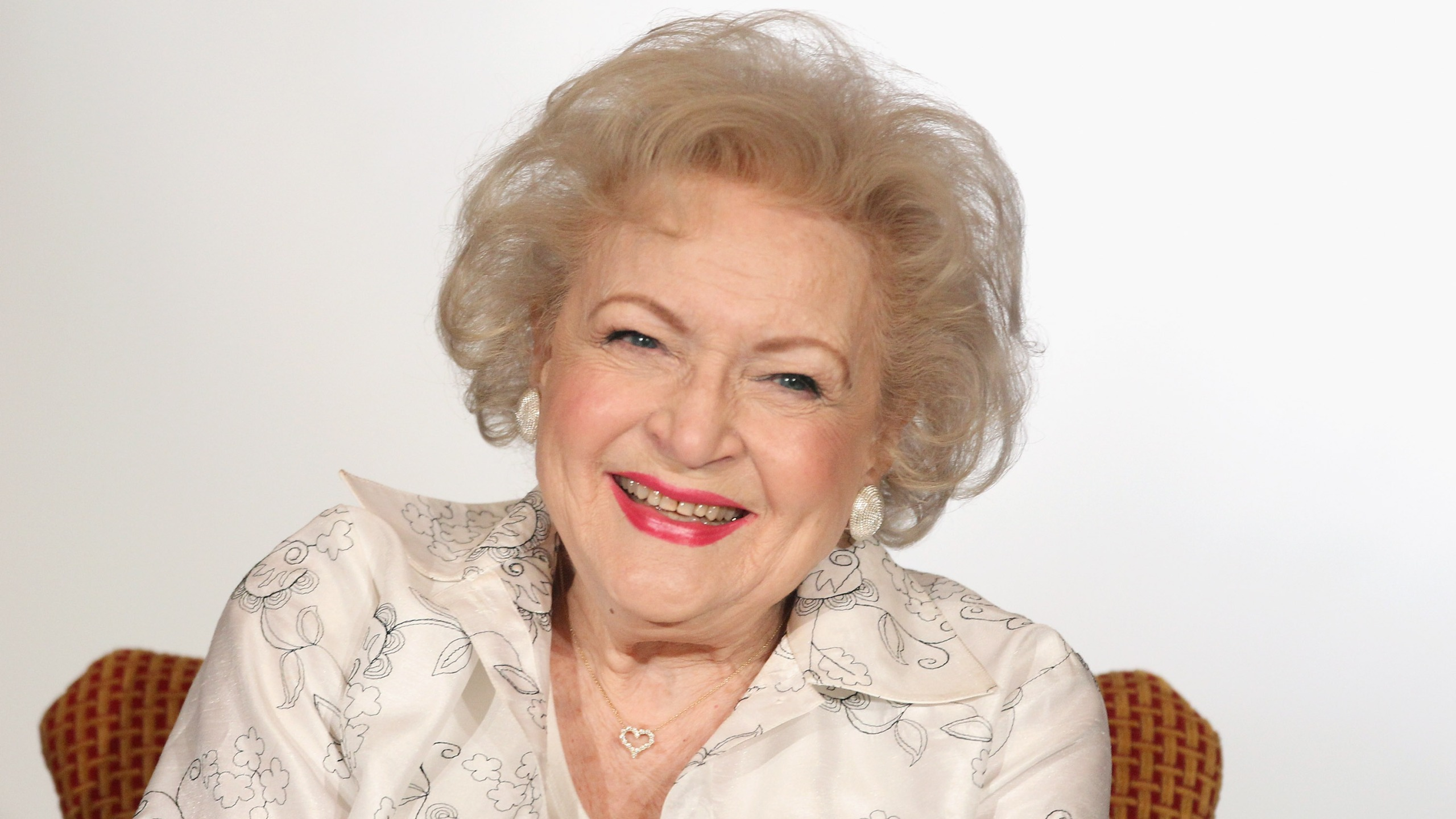 """Betty White speaks onstage during the Informal Session: Betty White's Off Their Rockers"""" panel during the NBCUniversal portion of the 2012 Winter TCA Tour (Photo by Frederick M. Brown/Getty Images)"""