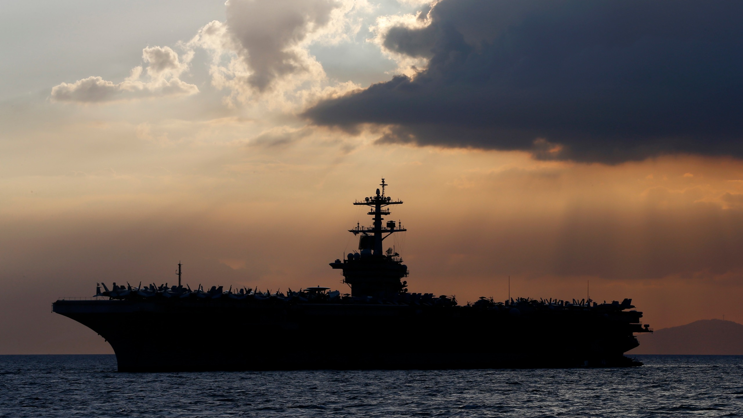 The aircraft carrier USS Theodore Roosevelt sits anchored off Manila Bay west of Manila, Philippines. (AP Photo/Bullit Marquez, File)