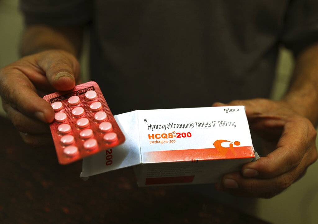 A chemist displays hydroxychloroquine tablets in New Delhi, India. Scientists in Brazil have stopped part of a study of the malaria drug touted as a possible coronavirus treatment after heart rhythm problems developed in one-quarter of people given the higher of two doses being tested. Chloroquine and a similar drug, hydroxychloroquine, have been pushed by President Donald Trump after some early tests suggested the drugs might curb coronavirus entering cells. (AP Photo/Manish Swarup, File)