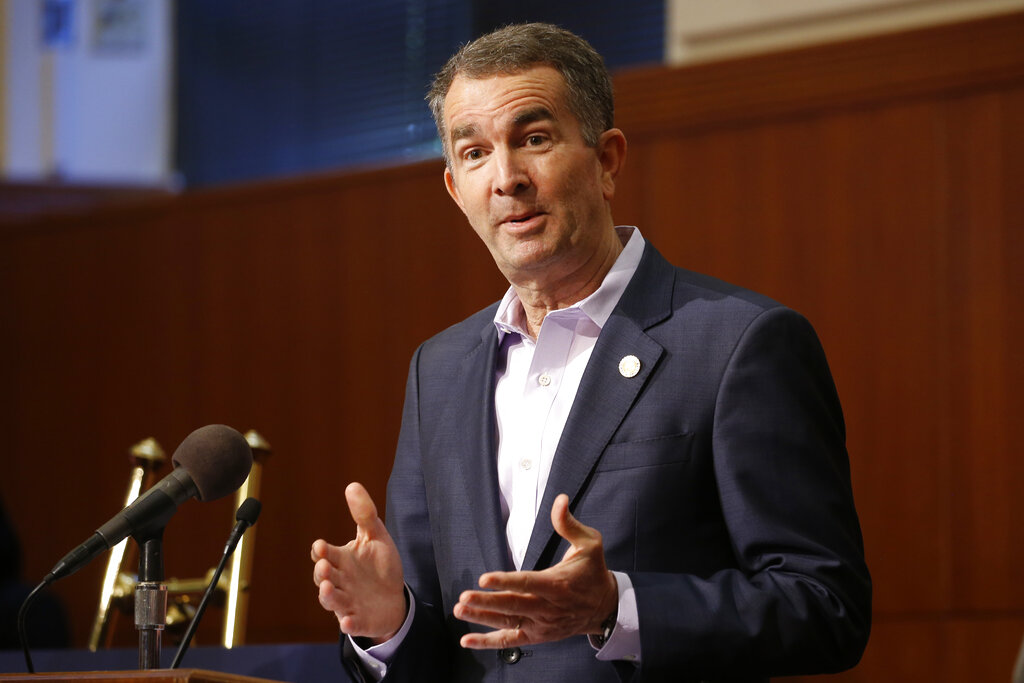 Virginia Gov. Ralph Northam gestures during a news conference at the Capitol Wednesday in Richmond, Va. (AP Photo/Steve Helber)