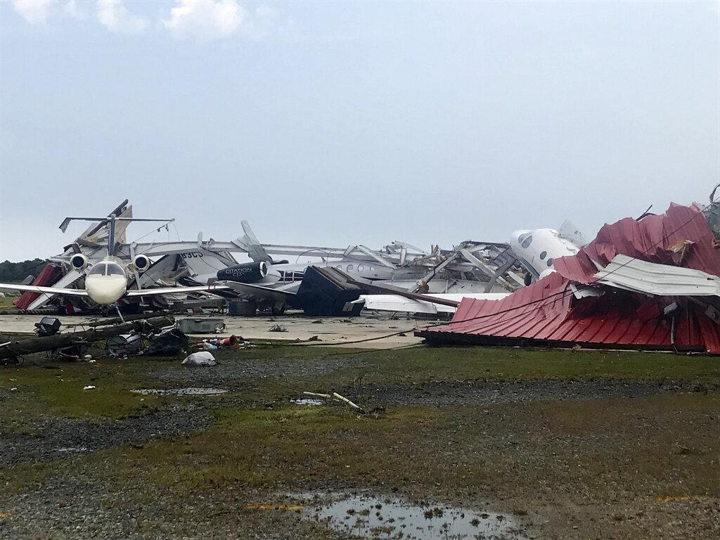 A destroyed hangar and damaged planes are seen at Monroe Regional Airport in Monroe, La., Sunday, April 12, 2020. (Monroe News Star/Greg Hilburn via AP)