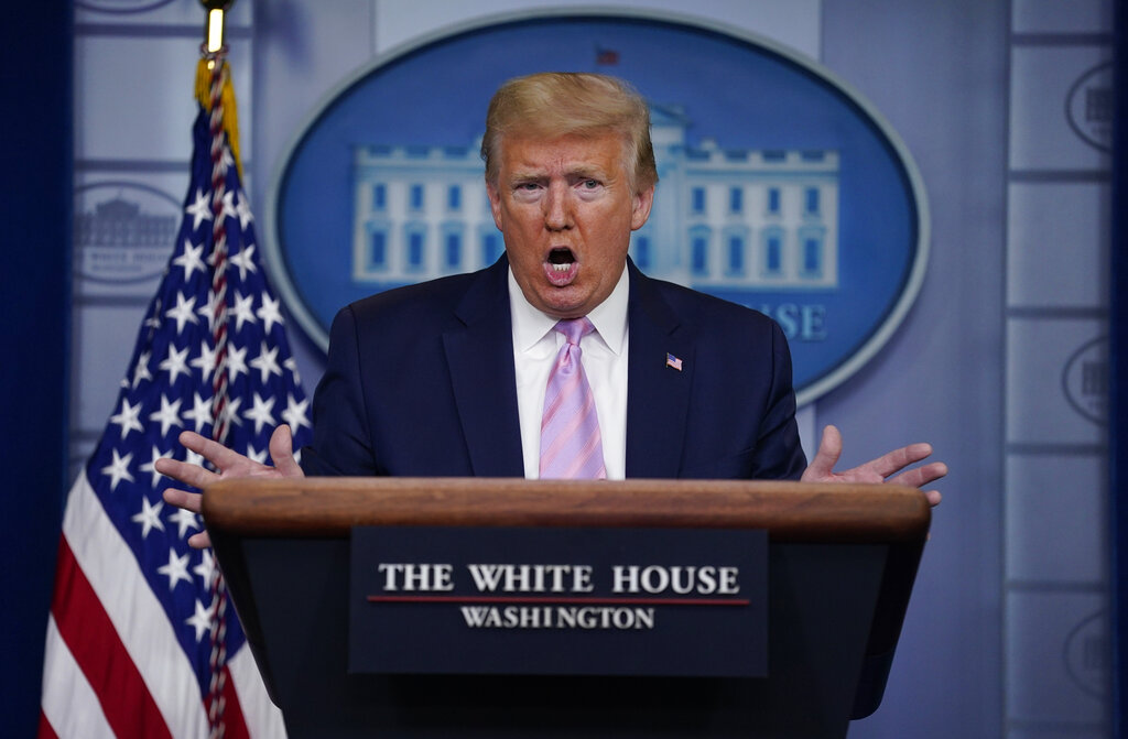 President Donald Trump speaks during a coronavirus task force briefing at the White House, Friday, April 10, 2020, in Washington. (AP Photo/Evan Vucci)