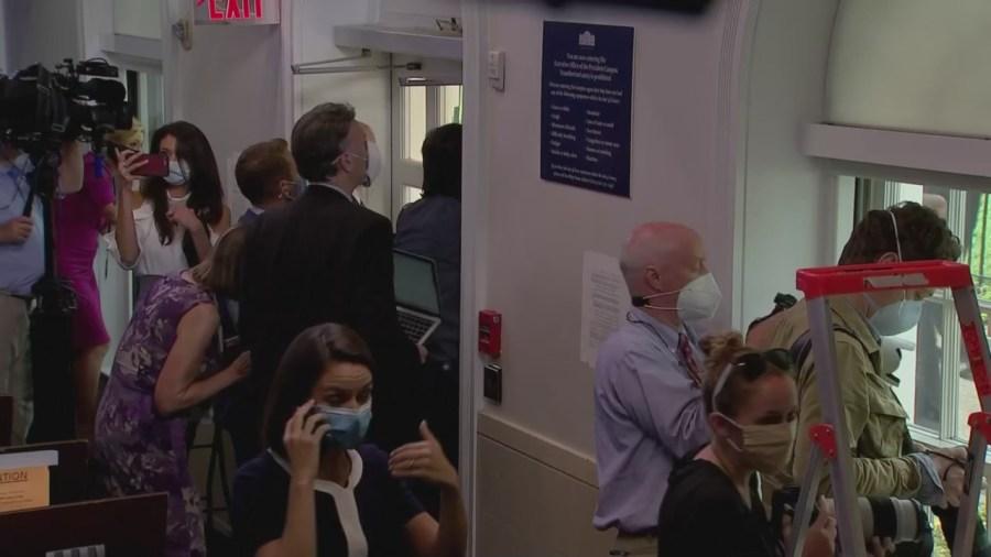 journalists crowd windows