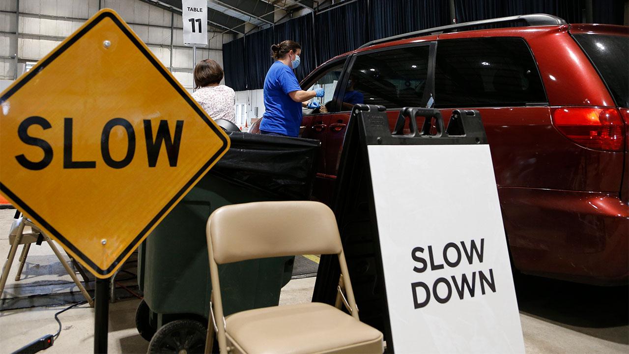 Celeste Center vaccine slow down sign